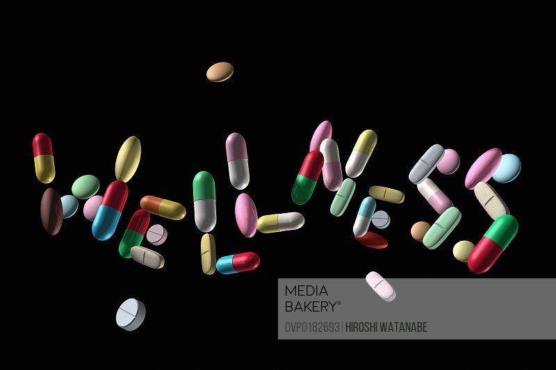 WELLNESS written with pills