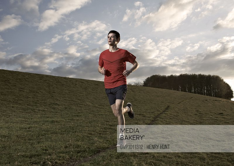 Male running on hill