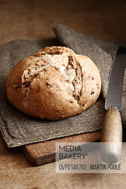 brown bread on chopping board on table