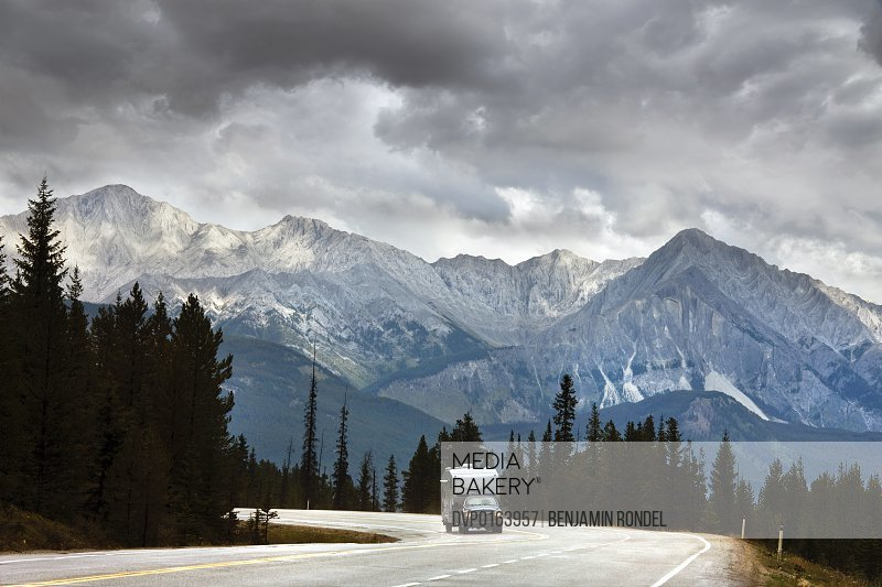 5th wheel travel/camping trailer being pulled by pickup truck through Canadian rockies