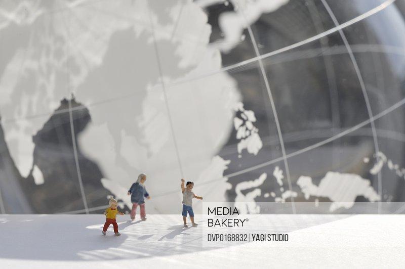 A child's miniature and globe