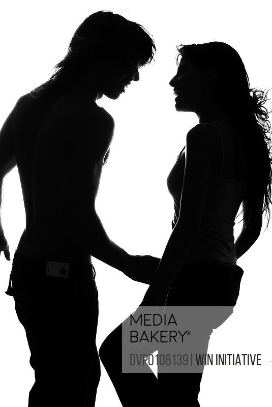 Silhouette of couple looking at each other
