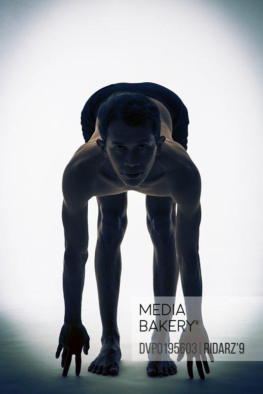 Asian man in Yoga pose