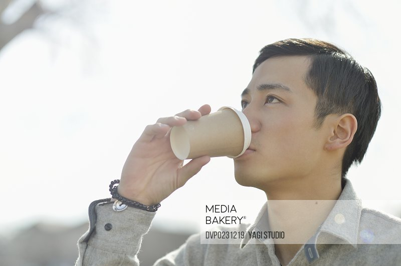 Asian man drinking coffee