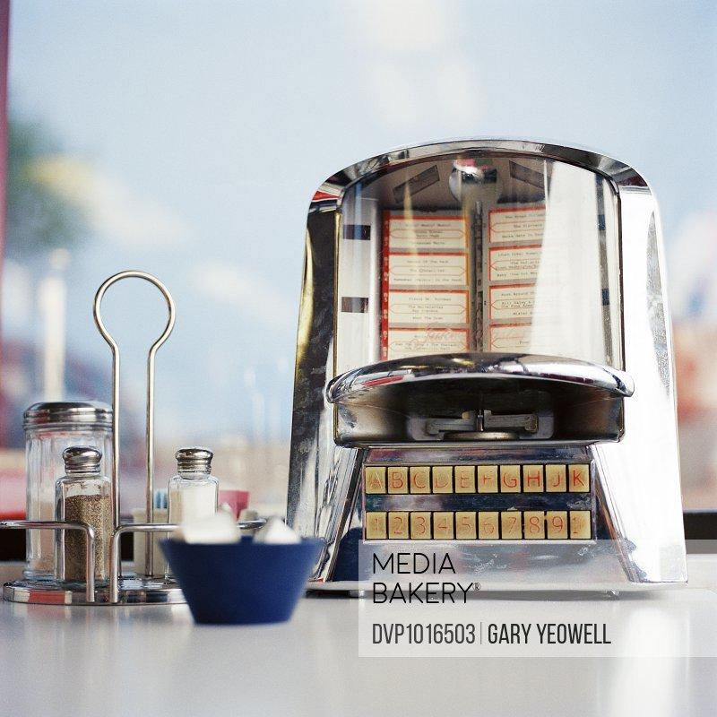 Juke box and condiments on a diner table
