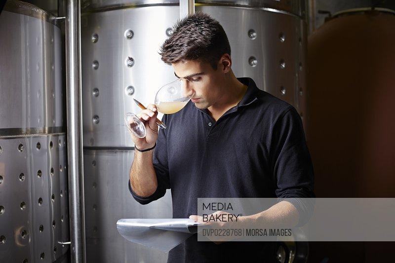 Wine expert smelling white wine samples