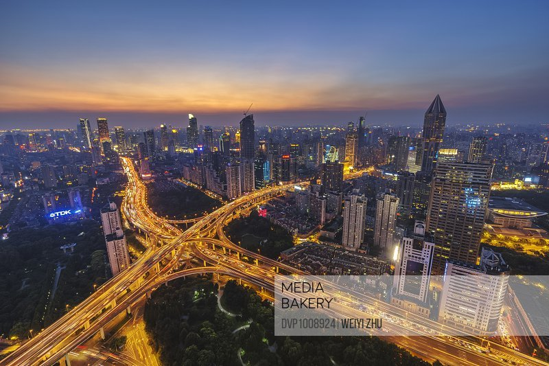 Elevated view of Shanghai highway at sunset.