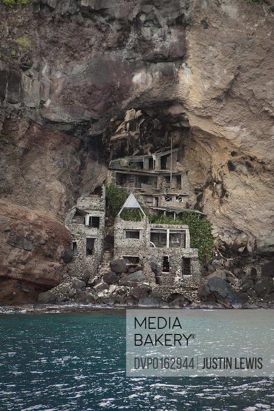 mediabakery photo by divine images old stone house built into the side of a cliff in st. Black Bedroom Furniture Sets. Home Design Ideas