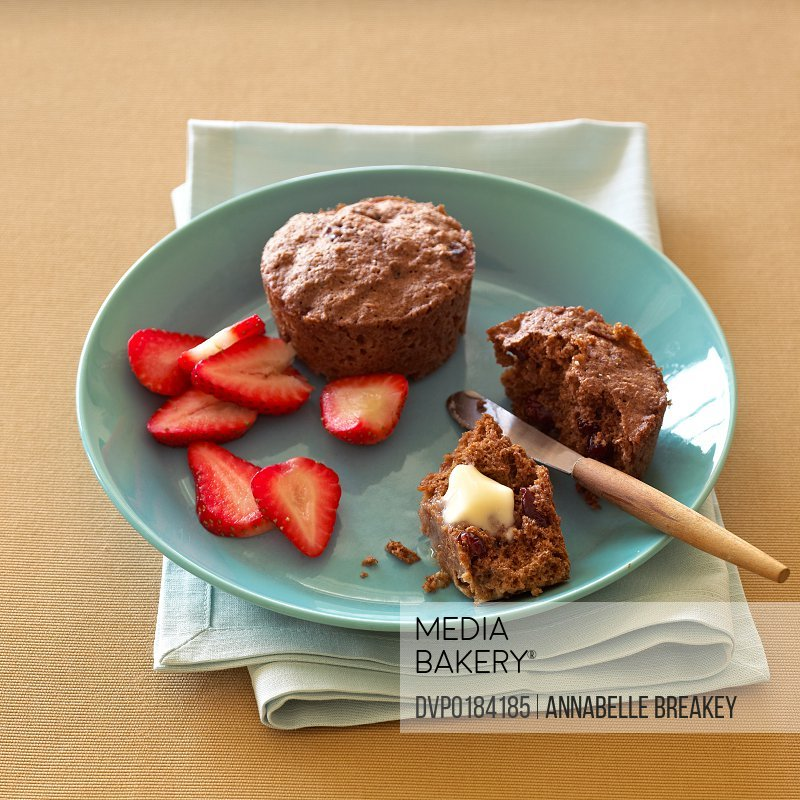 Breakfast Bran Muffin with Strawberries on Plate