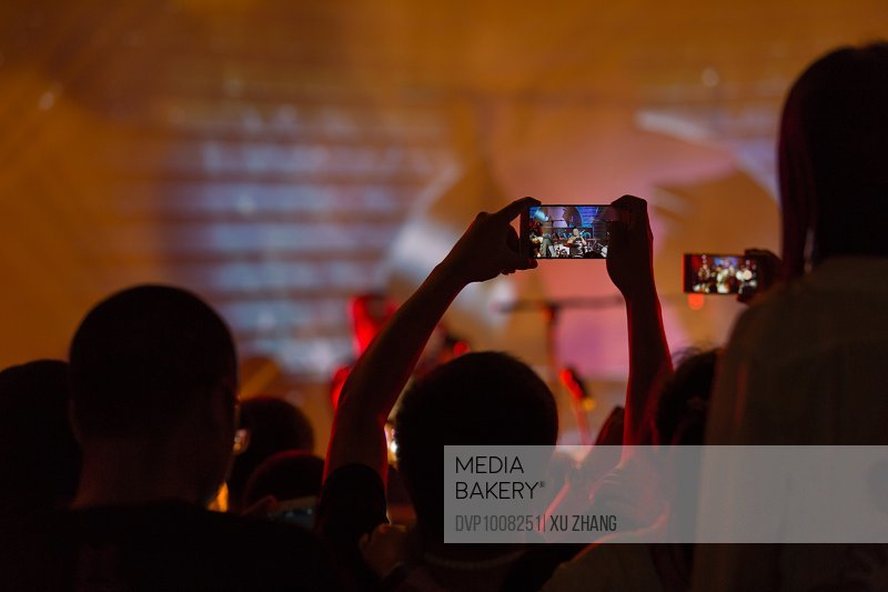 Crowd using smart phone at rock concert