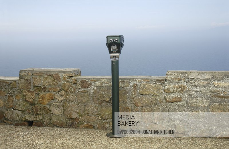 Coin operated binoculars at viewing point on coast