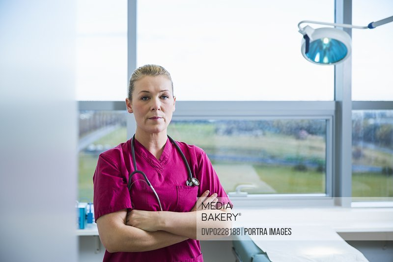 Portrait of confident female doctor standing arms crossed in hospital