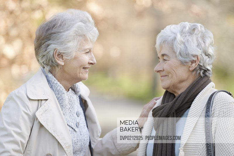 Two senior women bonding with one another
