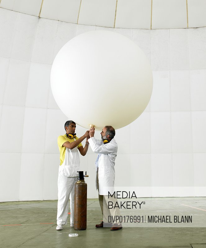 Scientists inflate weather balloon in lab