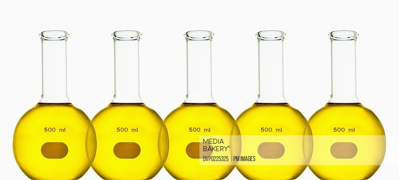 Chemistry glassware filled with yellow liquid