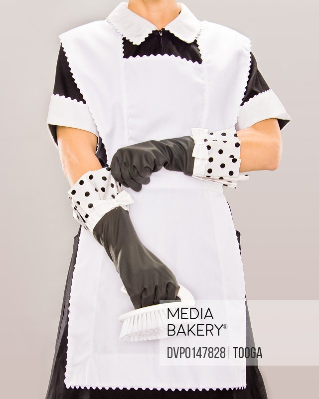 Maid wearing gloves and holding scrub brush