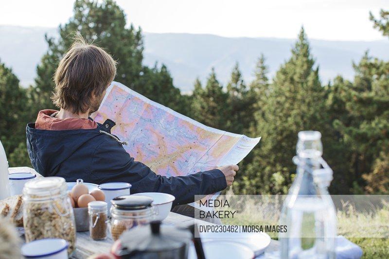 Man reading man at picnic table
