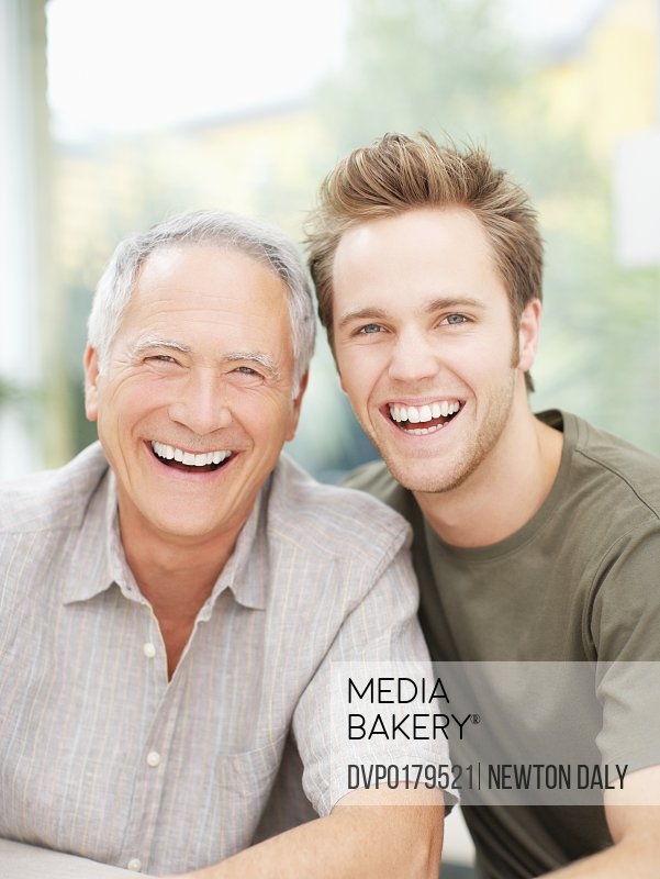 Portrait of mature father and adult son