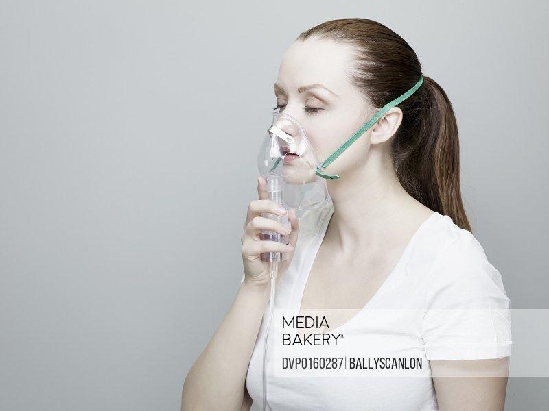 Woman Wearing An Oxygen Mask.