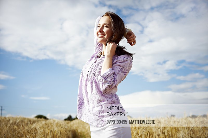 female smiling in cornfield