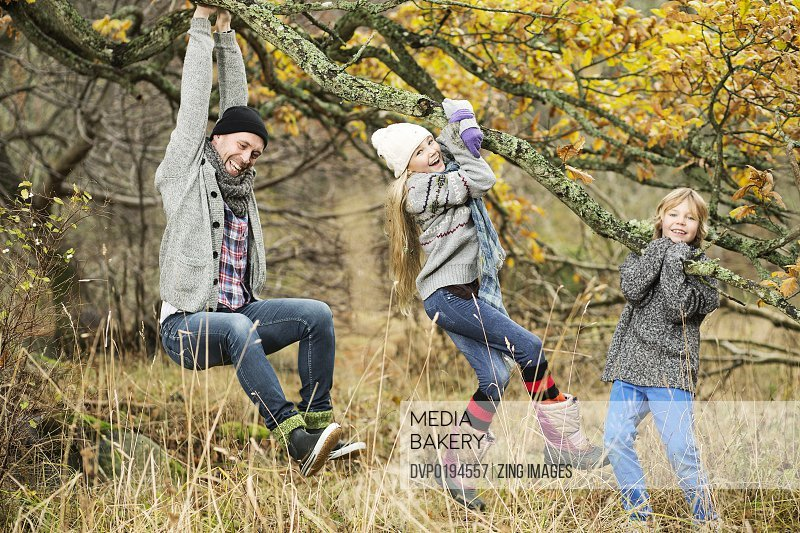 Father and children outdoors