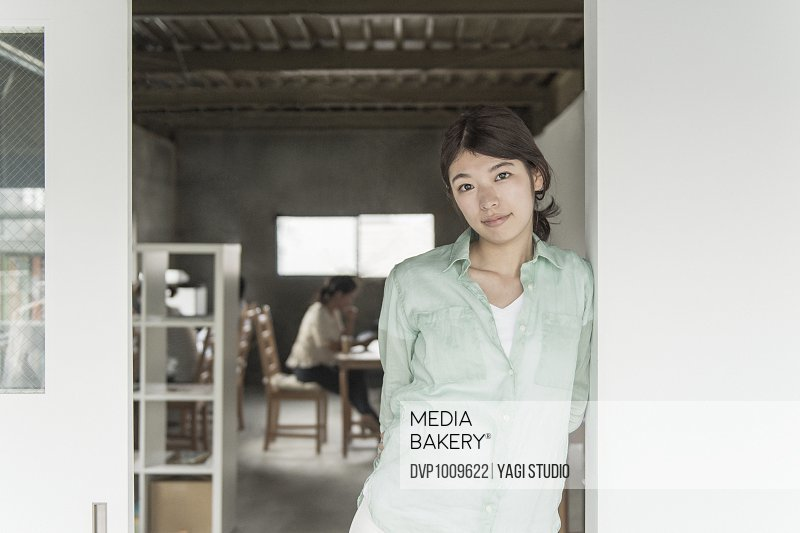 Woman standing at workstation