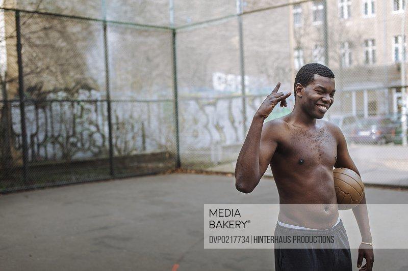 African Man At Urban Soccer Ground