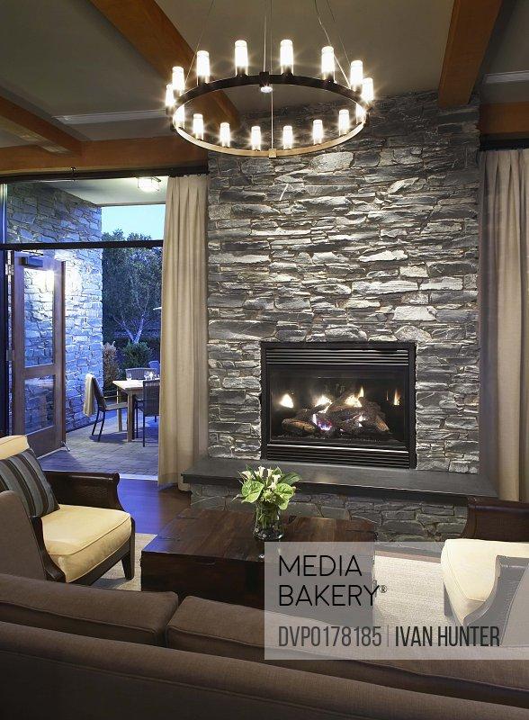 Fancy chandelier with elegant fireplace