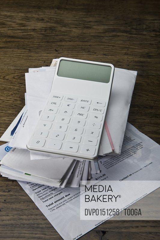Still life of calculator and bills