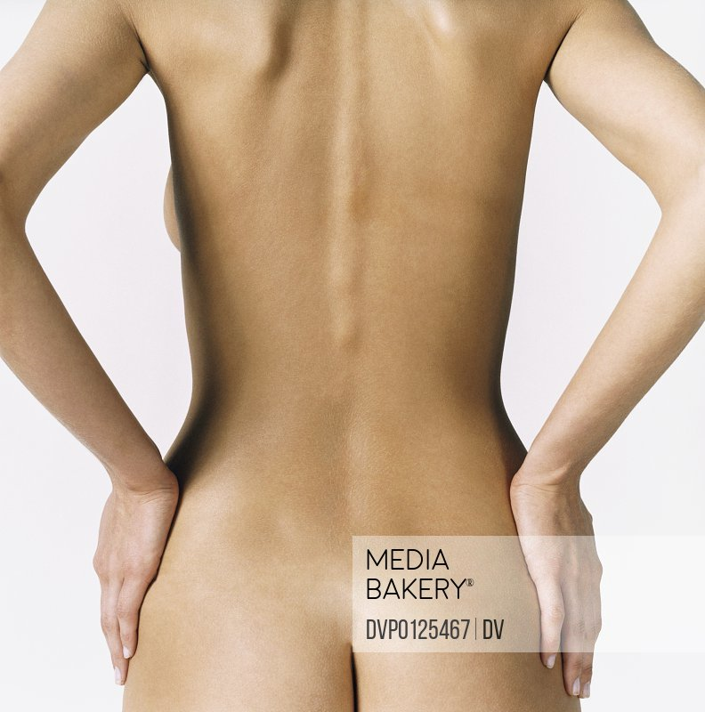 Back of a Naked Woman With Her Hands on Her Hips