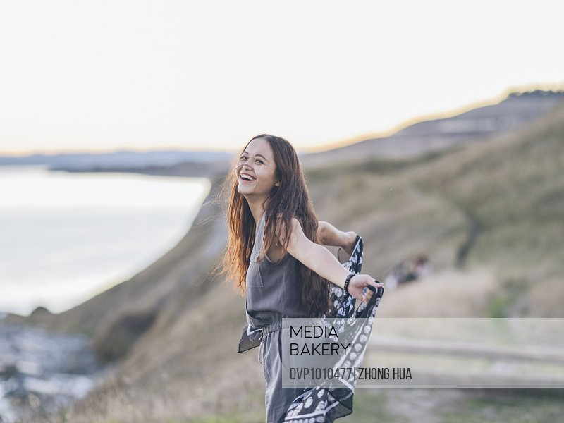 asian female walking at cliff