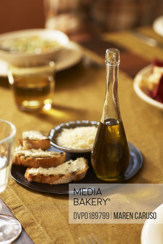 Bread and olive oil on table
