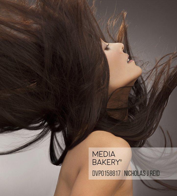 beautiful woman fliping her long hair