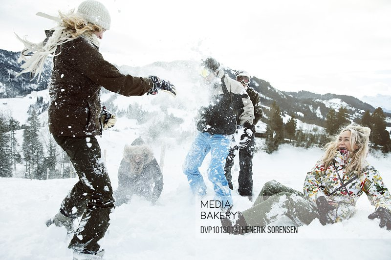 young people on winter holiday, snowfight
