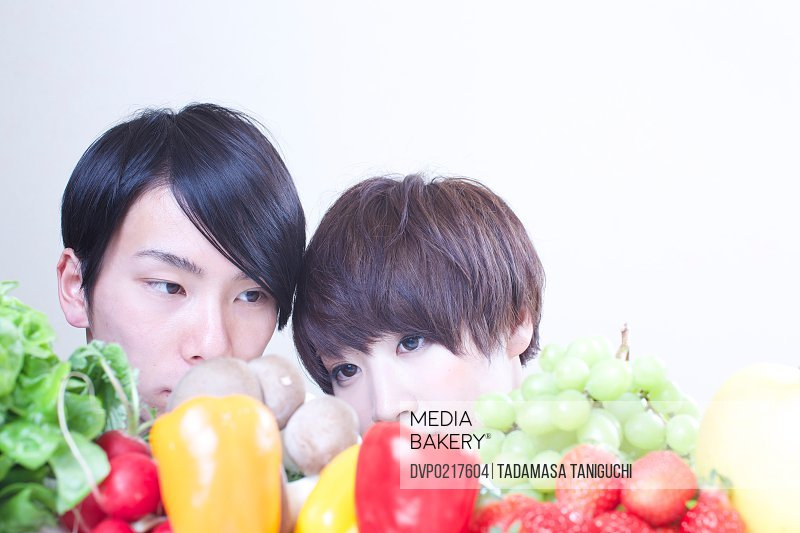 Young couple looking at vegetables