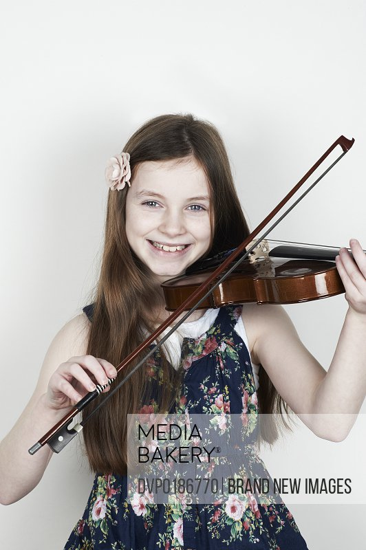 Portrait of girl playing musical instrument