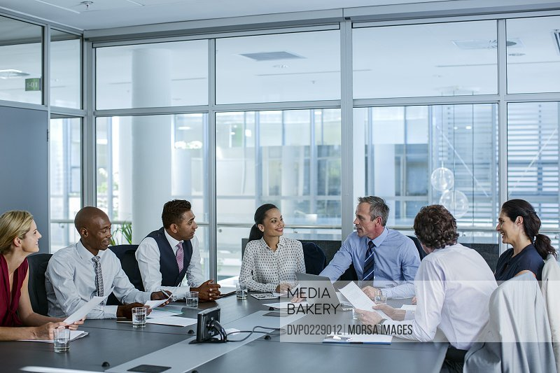 Businesspeople discussing at conference table
