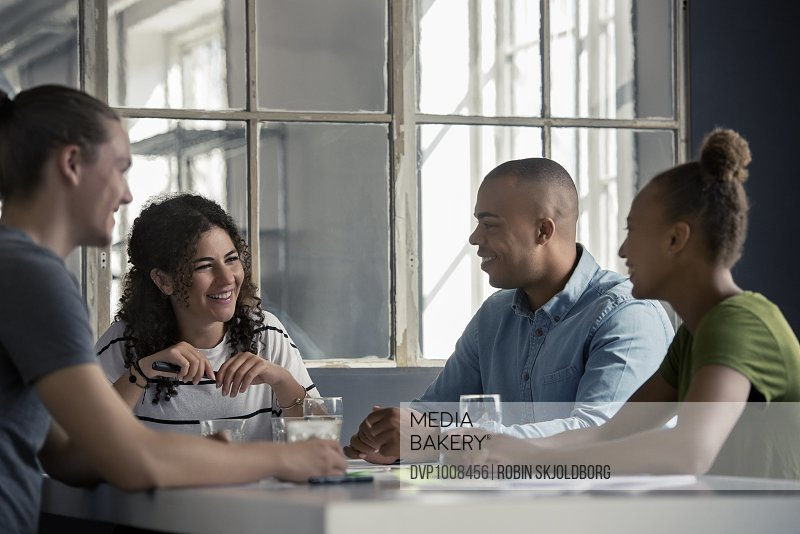 Young people laughing during meeting