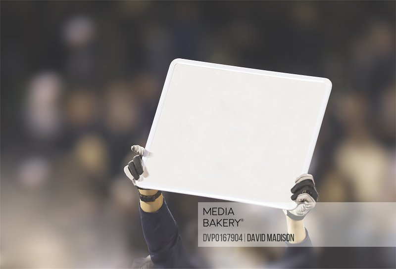 Person holding up blank sign
