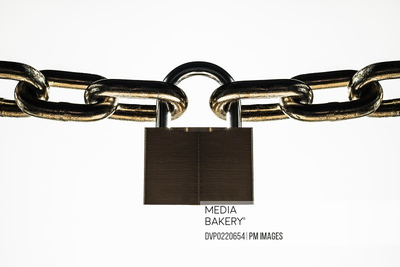 Padlock connecting two ends of steel chain