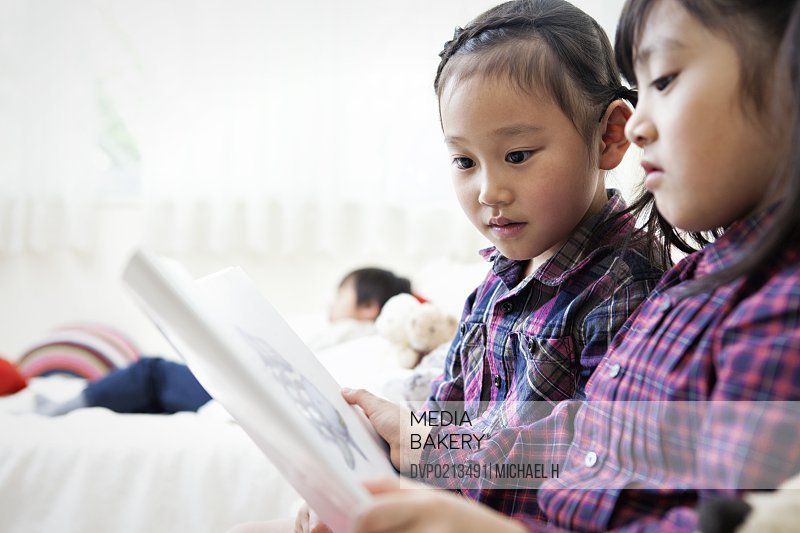 Two girls looking at a picture book