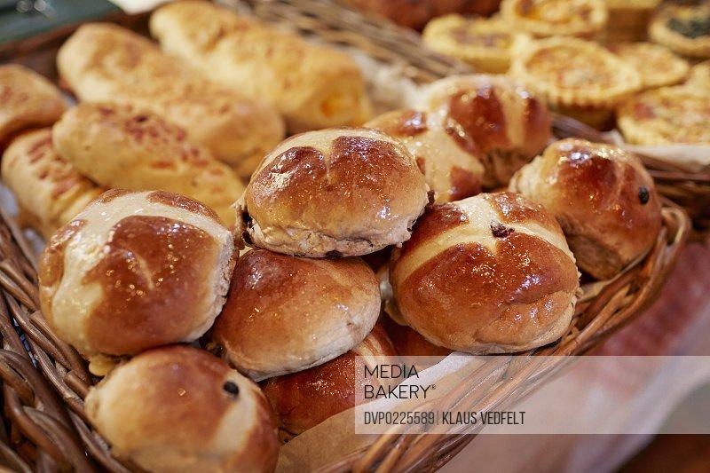 Close-up of freshly baked organing raisin buns