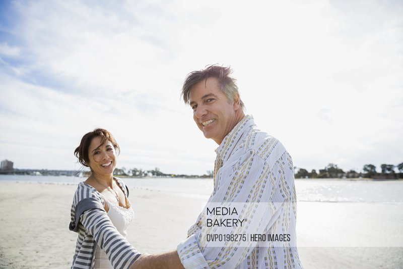 Portrait of smiling mature couple on beach vacation