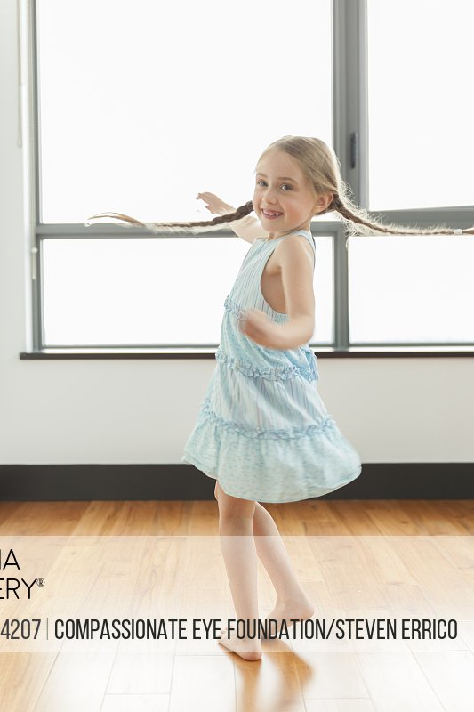 Girl 6-7 spinning indoors
