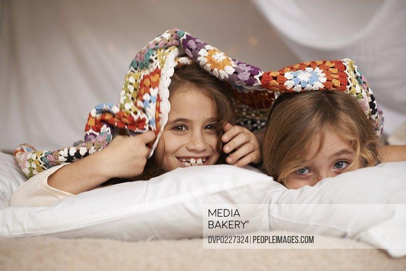 Shot of two cute little girls having a sleepover