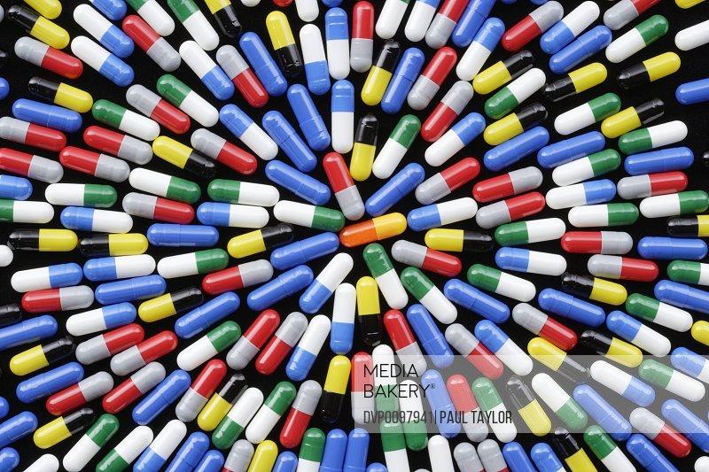 Arrangement of coloured medicine capsules