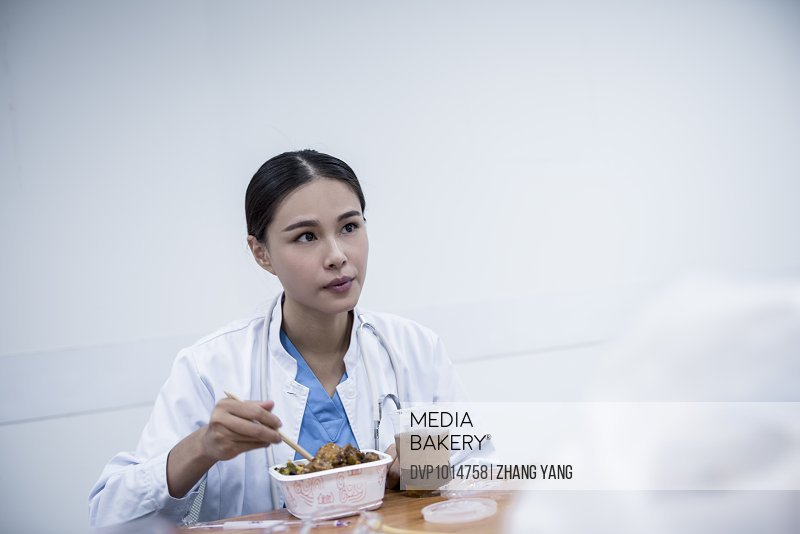 Doctor eating in office