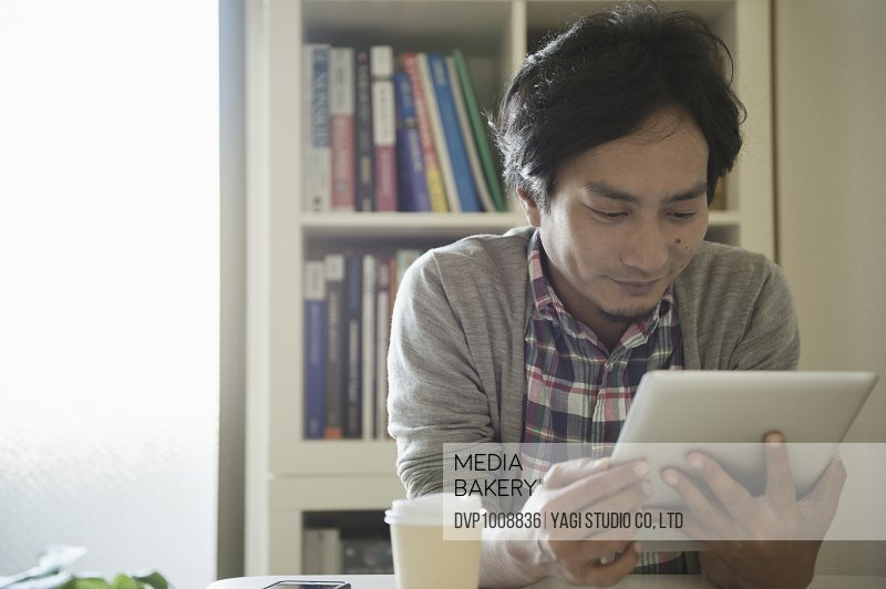 Man of casual clothes working at private office,Japan,Kyoto
