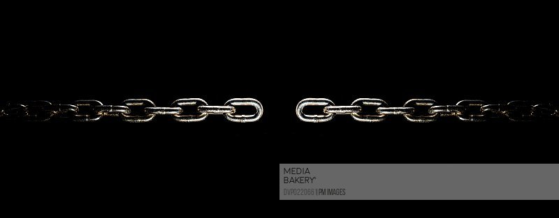 Steel chain on black background with one link missing