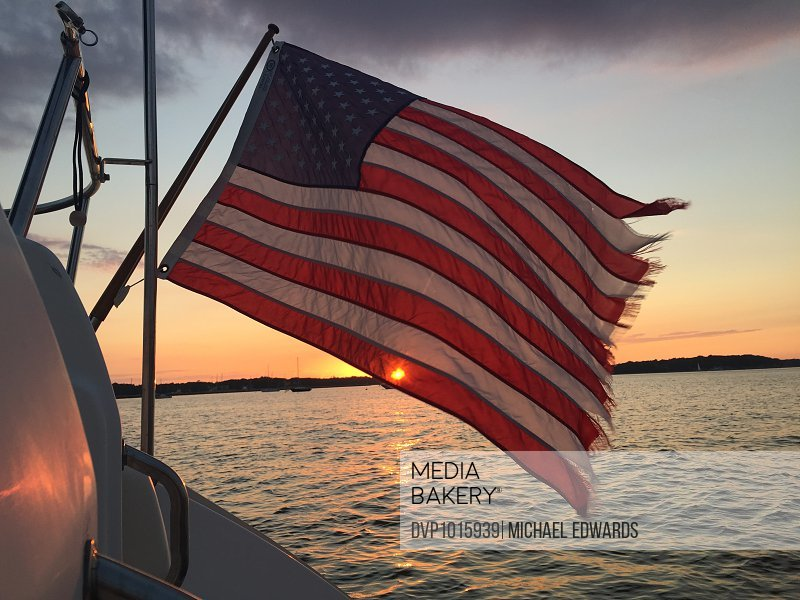 American Flag on boat at sunset